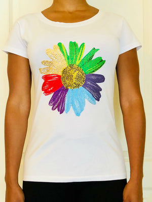 White short-sleeved T-shirt with colored bedazzling flower design.