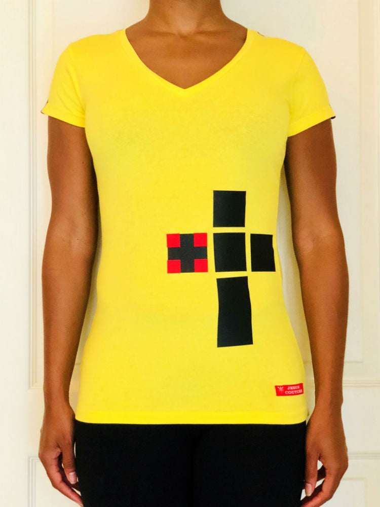 Yellow short-sleeved V-Neck shirt with black/red boxed cross on lower left side of the front.