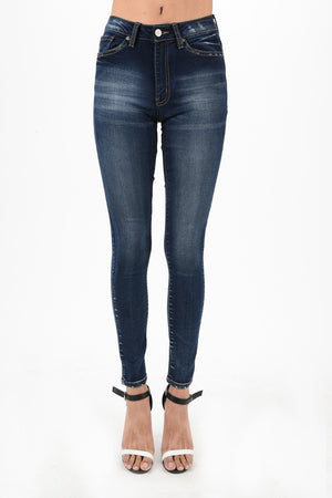 KanCan Mid-Rise Skinny Jeans. Slim skinny with a touch of white fade. Dark jean washed.
