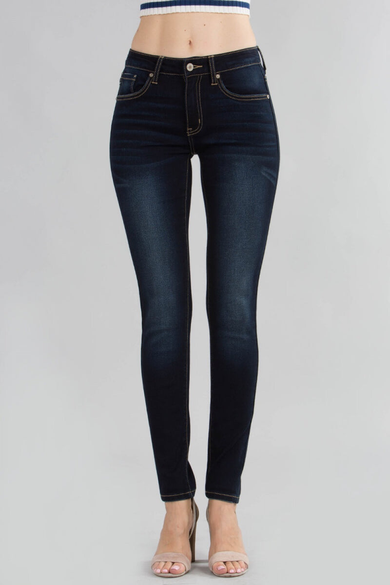 Dark wash skinny jeans with contrast topstitching and mild whispering