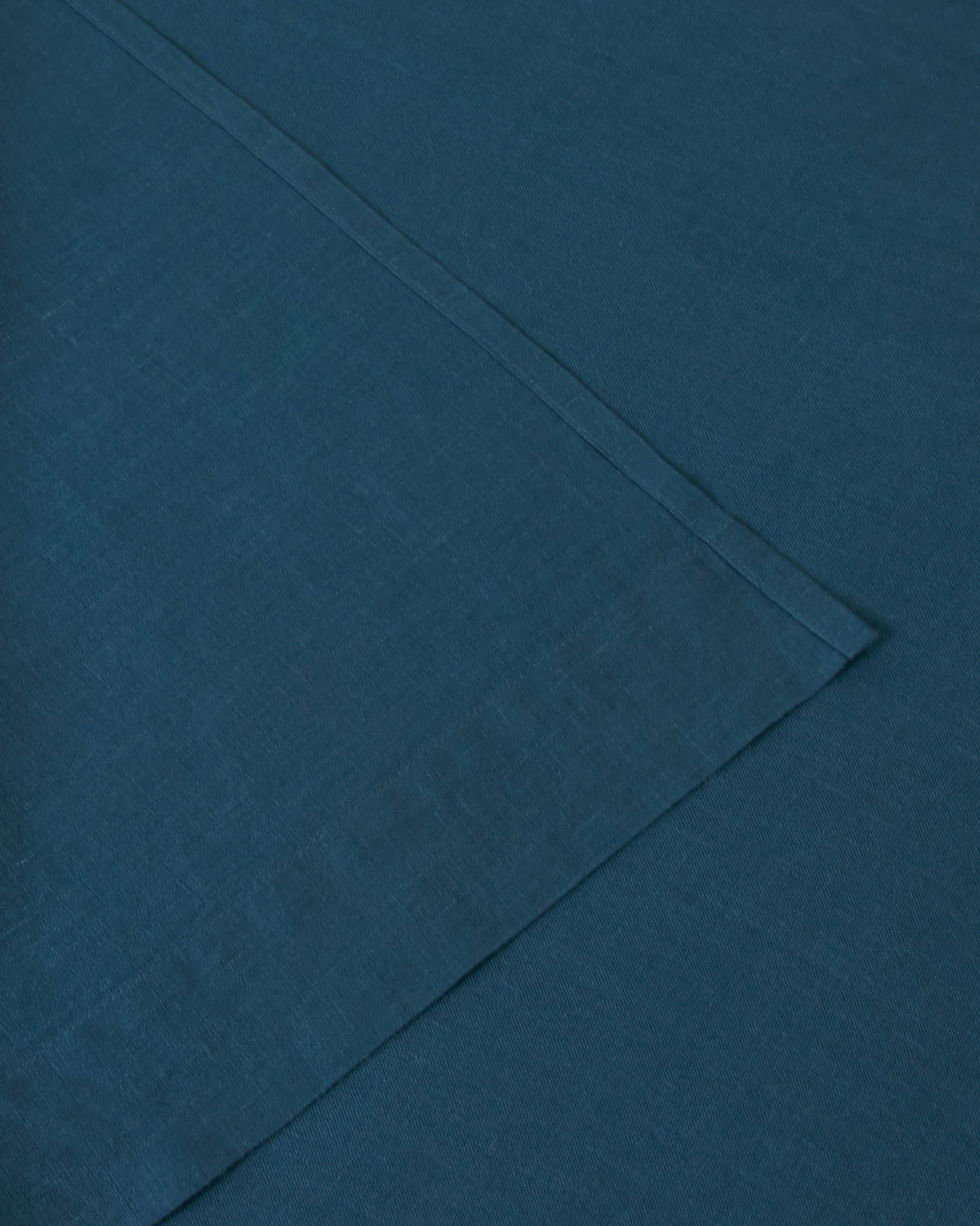 Linen sheets collection set in a dark blue adriatic indigo color