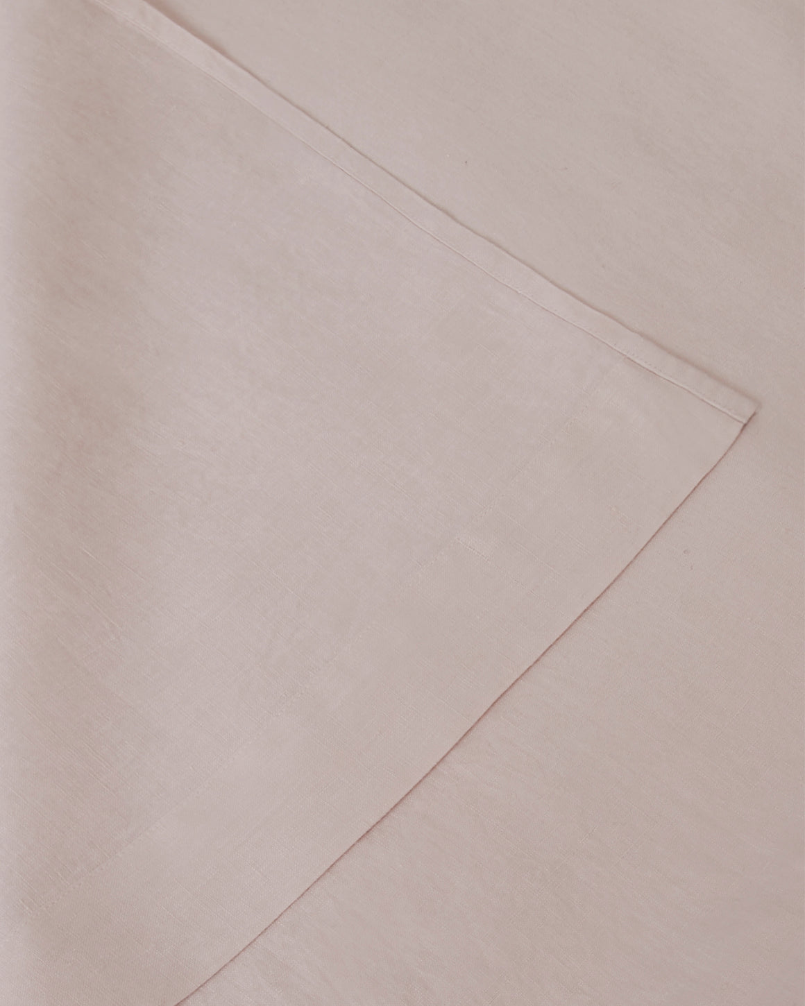Close up of light pink blush sheet set