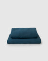Image of dark adriatic blue flat and fitted sheet set