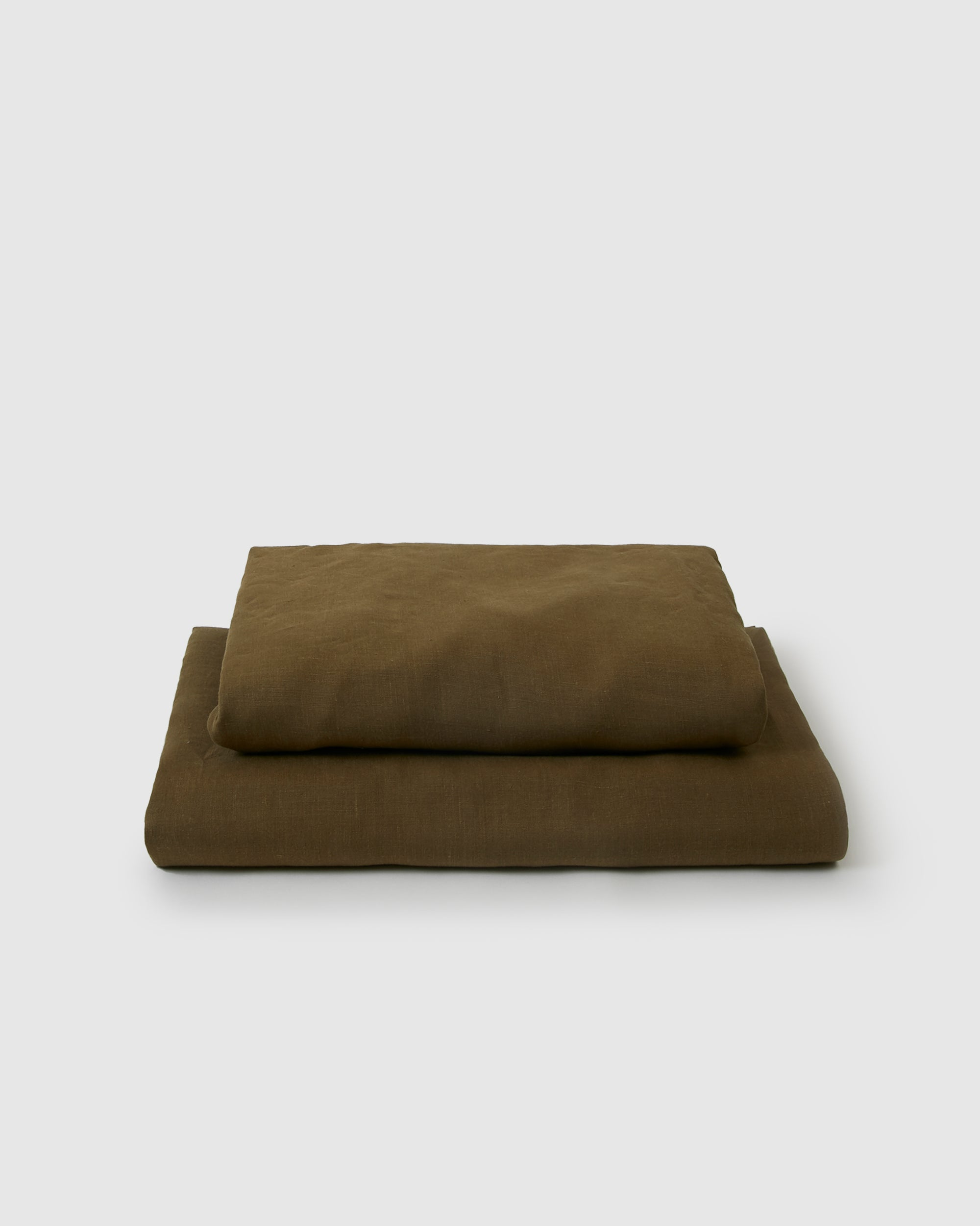 Image of moss green flat and fitted sheet set