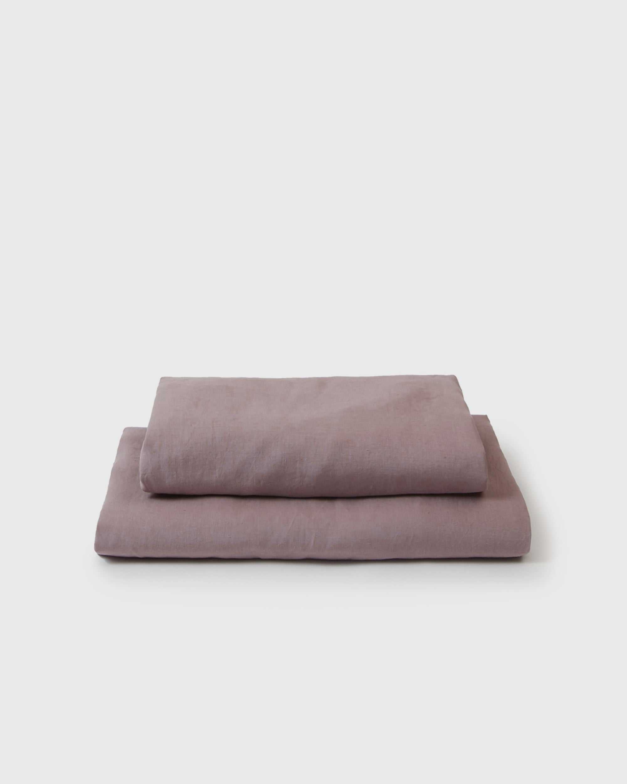 Image of dark pink orchid flat and fitted sheet set