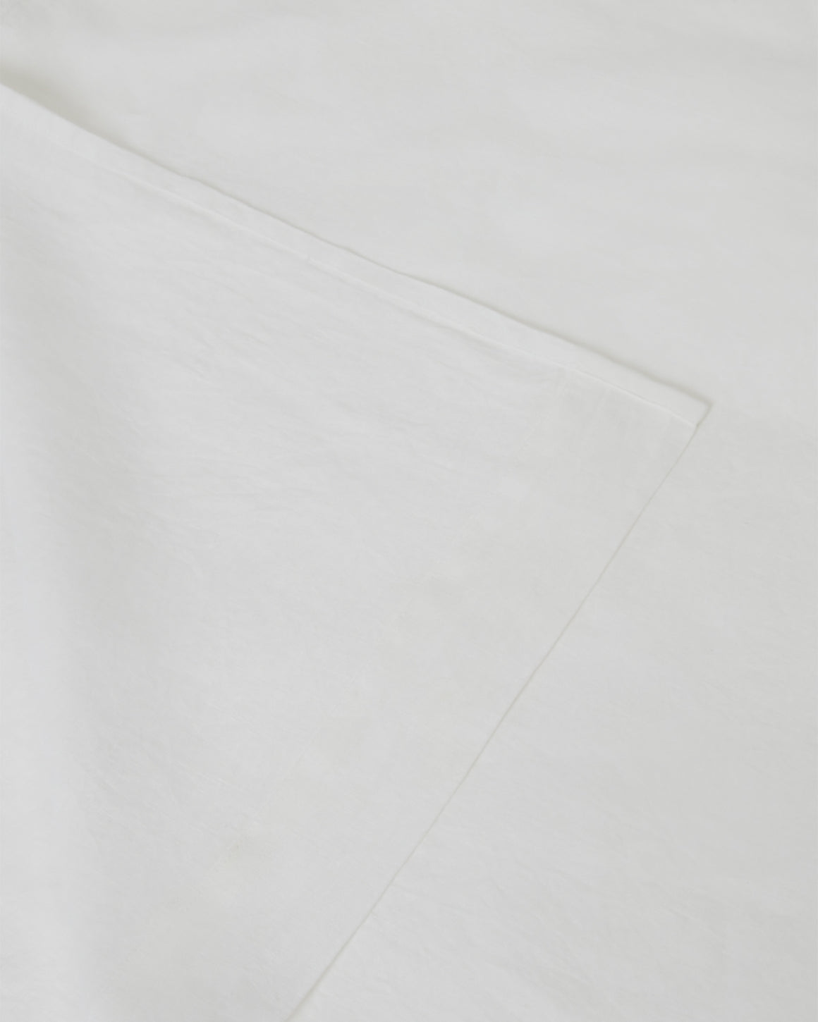 Image of creamy white milk flat and fitted sheet set