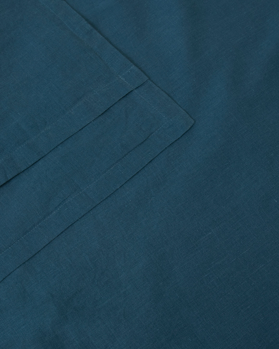Pair of filled pillowcases in dark blue adriatic