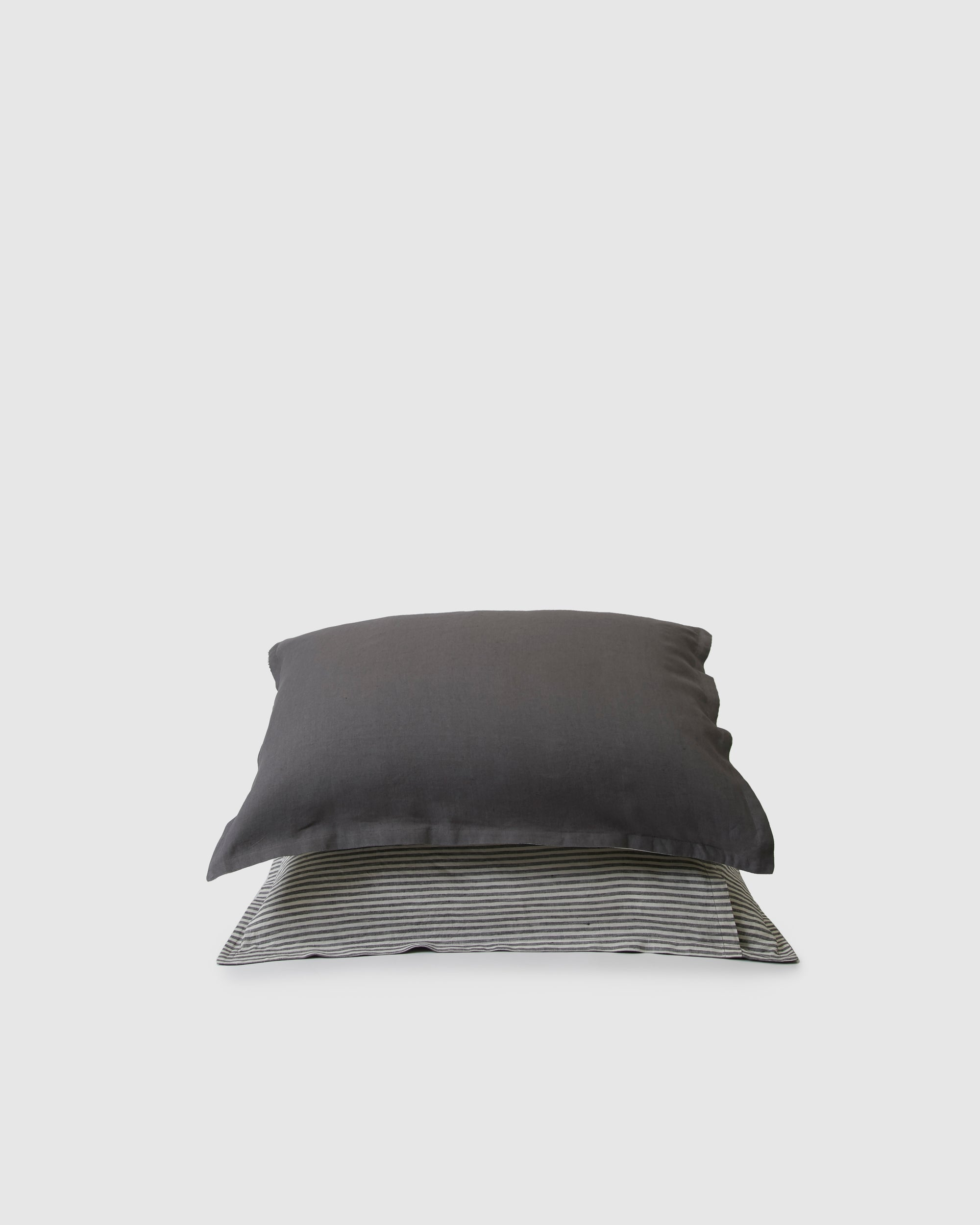 Pair of filled pillowcases in storm and storm stripe dark gray