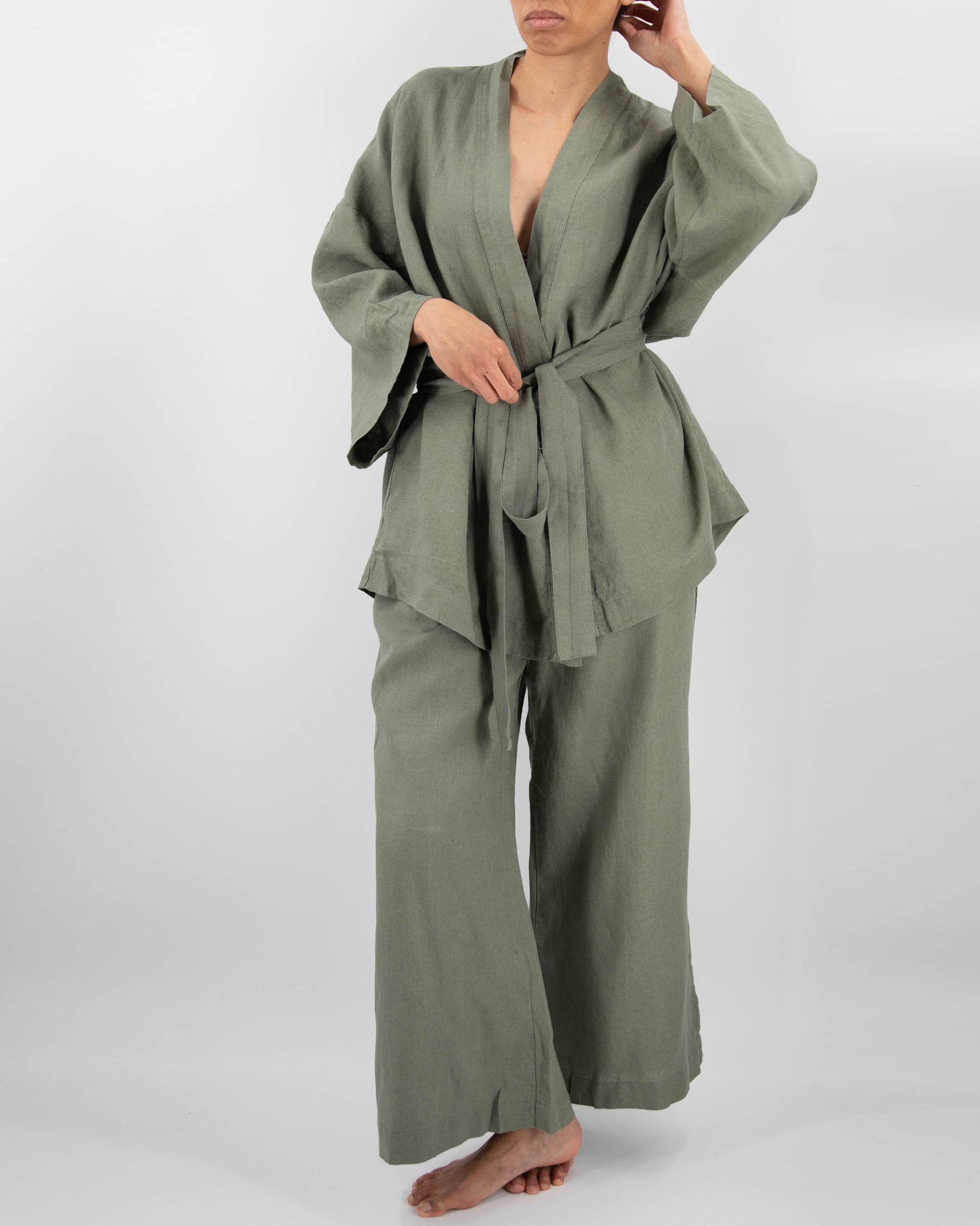 Kimono style loungwear set (top and pants) on model in charcoal black
