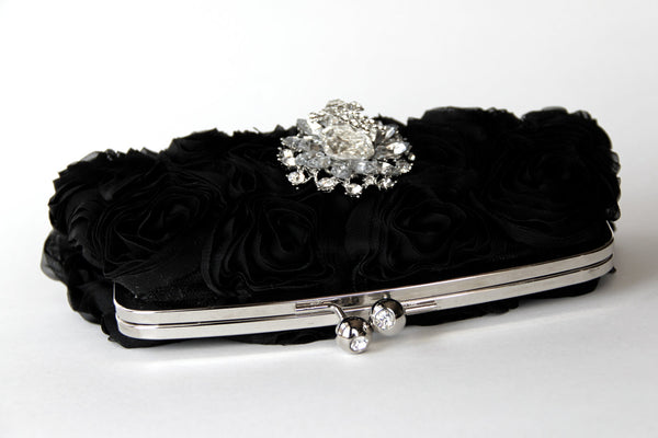 Black Wristlet Clutch Purse made w/ Silk Rosettes. Comes complete w/ a gorgeous Swarovski crystal accent. One-of-a-kind evening bag.