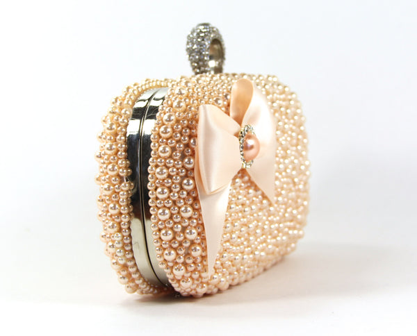 Clutch Purse - Peach Pearl Wristlet adorned with a Lovely Satin Bow & Matching Pearl surrounded by Rhinestones - The Love Story