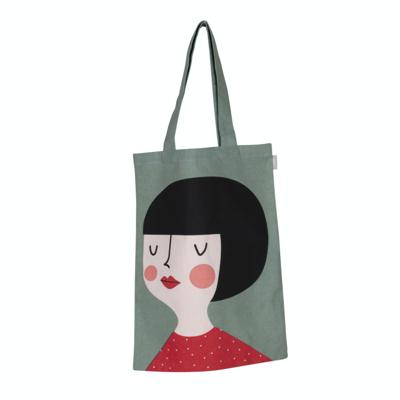 Kerstin Tote Bag, Light Sage Green bag.  Kerstin has a black bob hair style and bright pink cheeks.