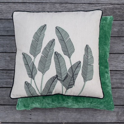 Cream cotton cushion, black & green palm leafs print. Black pipping edge.