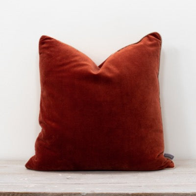 Rust Velvet Cushion 50x50xm with cream cotton piping for the ultimate luxury look