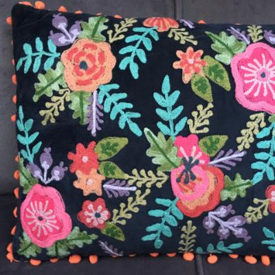 Gladys & Charles, Black Hand Embroidered Floral Filled Cushion with Orange Pom Poms