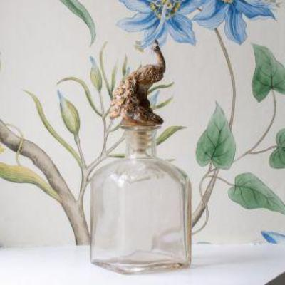 Peacock Glass Bottle.  Clear glass bottle with wood effect Peacock stopper.