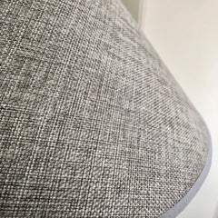 Close up view of the textured grey lamp shade of the Fabio Lamp