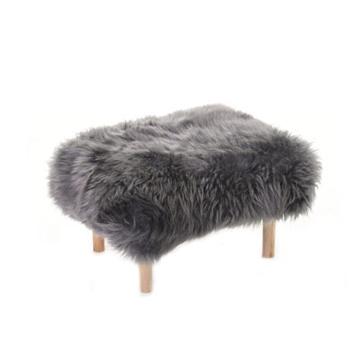 Slate grey sheepskin rectangle low stool, with 4 wood legs