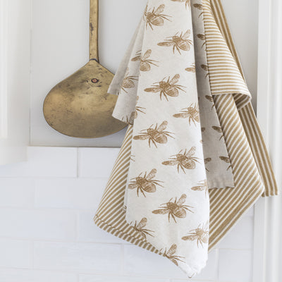 Recycled Honey Bee Tea Towel 2 Pack, Mustard. One with a honey bee pattern and the other with a complimentary stripe pattern.
