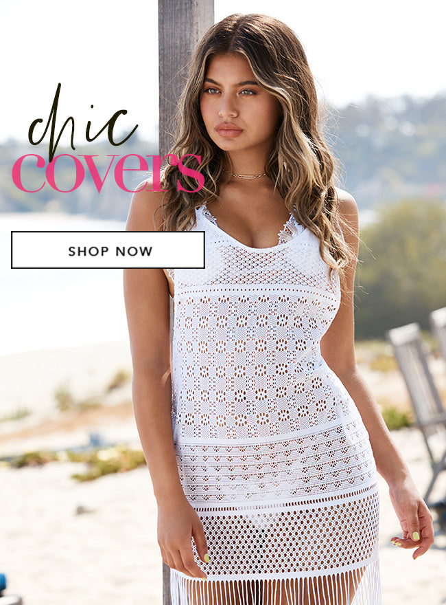 Girl in a white cover up. Shop Cover Ups