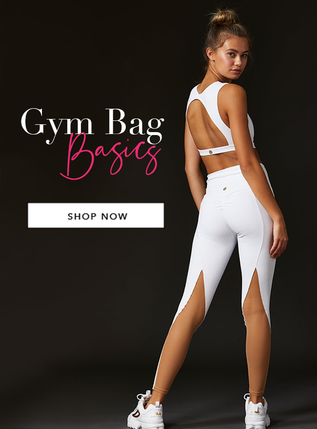 Gym Bag Basics - Model is wearing the Chloe Crop Top & Melanie Legging in White.
