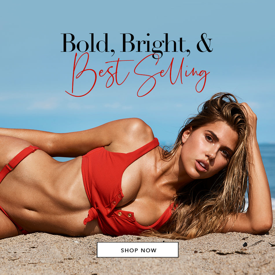 Bold, Bright, & Best Selling - Model is wearing the Rib Tide Knot Top and Adjustable Skimpy Bottom in Red