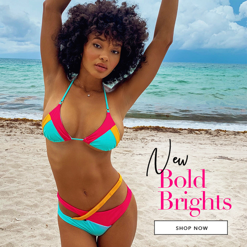 New Bold Brights - Model is wearing the Skylar Wrap Top & Skimpy Bottom in Barbie/Frozen/Soleil