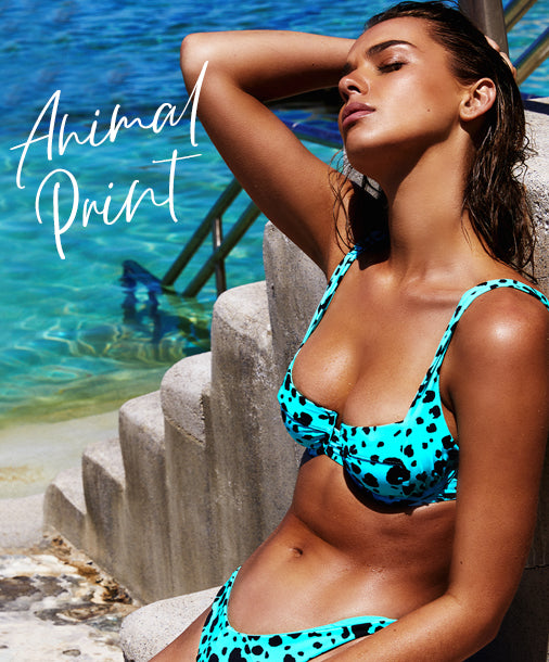 Animal Print - Model is wearing the Karter Bralette & Sydney Tango Bottom in Animal Dot Black/Aqua.