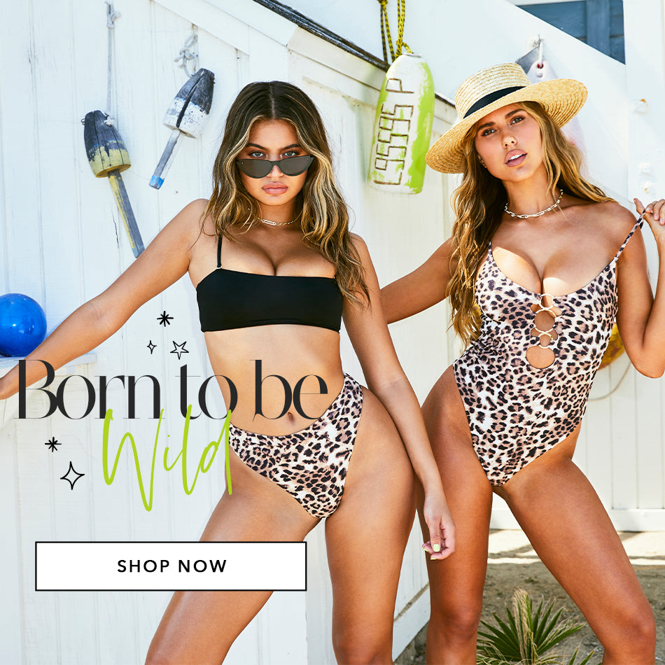 Two girls in leopard print bikinis. Shop Animal Prints