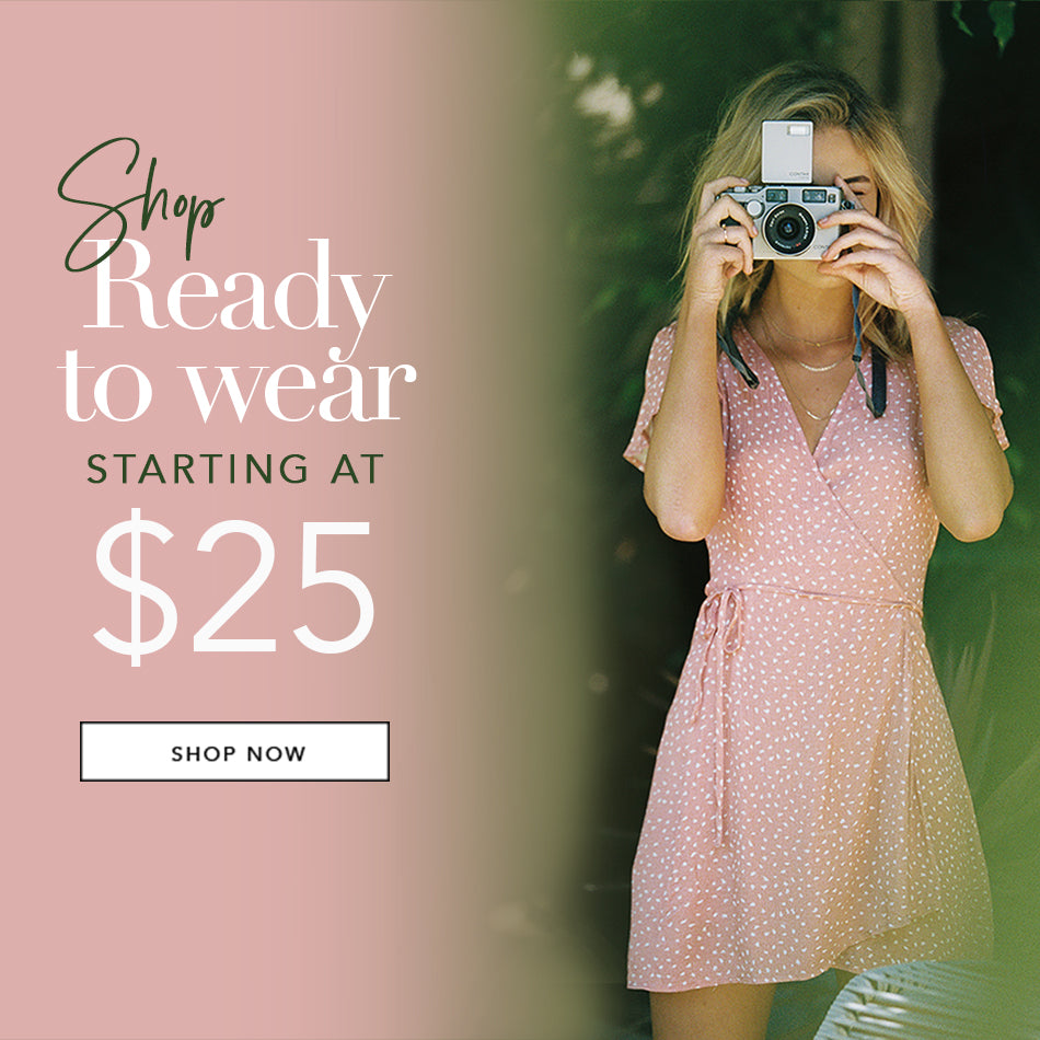 Shop Ready to Wear Starting at $25 - Model is wearing the Teagan Wrap Dress in Rose