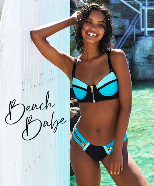 Beach Babe - Model is wearing the Endless Summer Push Up Top & Skimpy Bottom in Black/Maldives/Aqua.