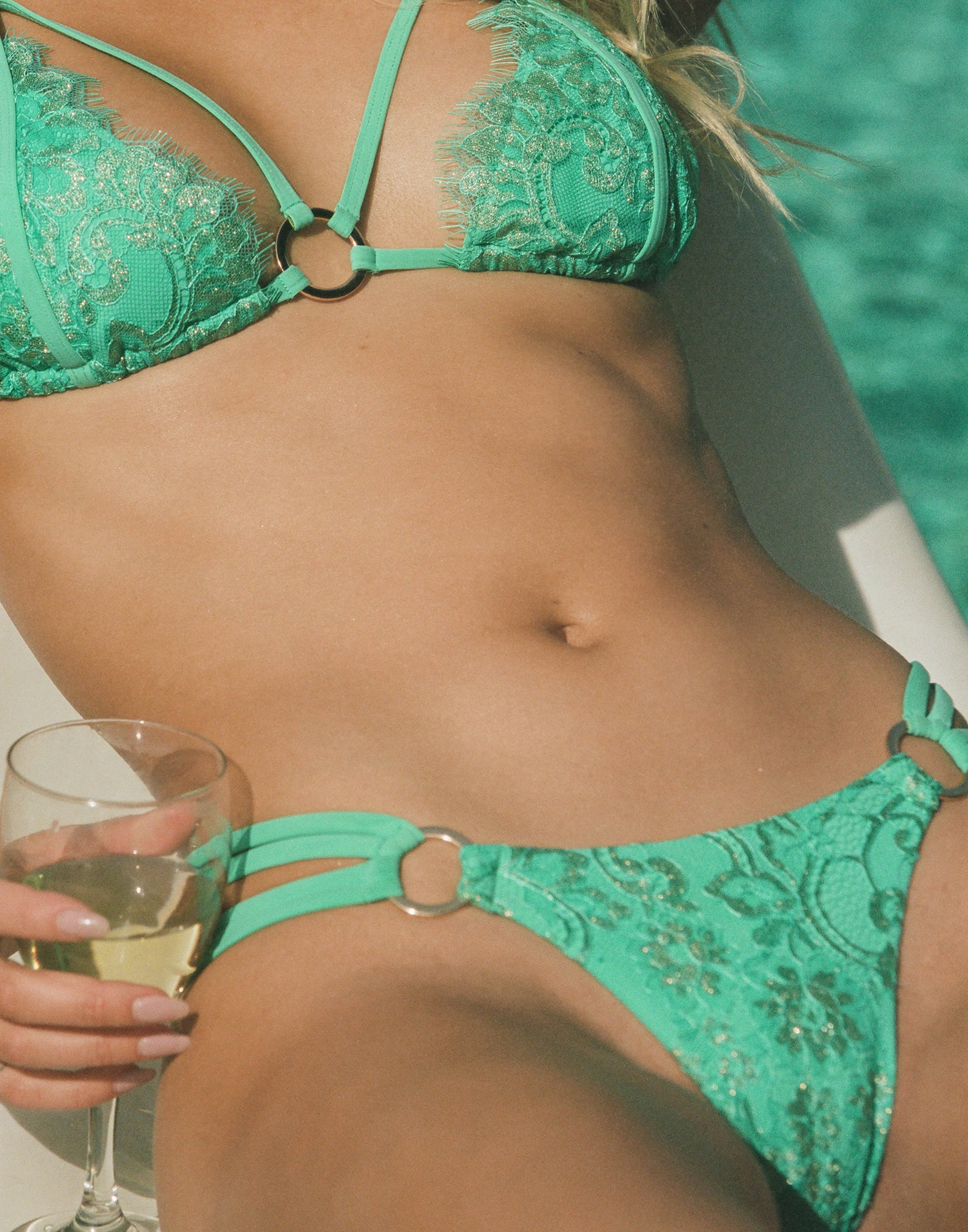 Gunpowder & Lace Skimpy Bikini Bottom in Seafoam with Strappy Details and Gold Ring Hardware - Detail Front View / Summer 2021 Campaign - Josie Canseco
