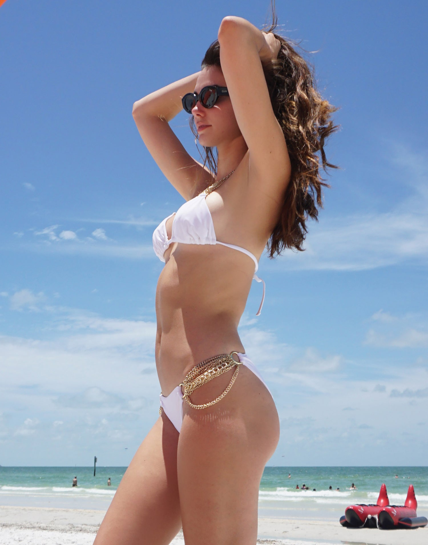Ball and Chain Skimpy Bikini Bottom in White with Gold Cascading Chains - Side View