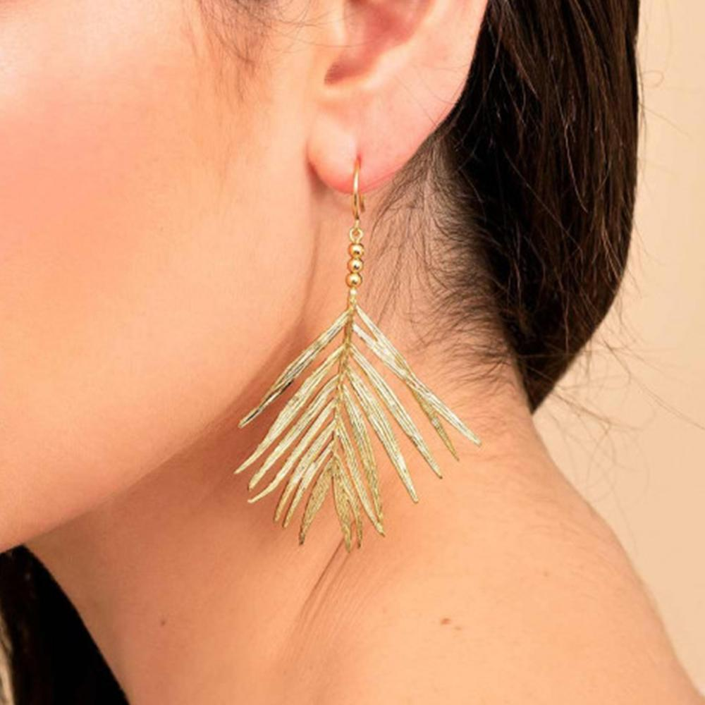 Palm Drop Earrings On Model