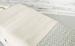 Cream Linens with a Cream Quilted Blanket & an Angle Seaspray Premium Saddle