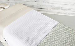 Cream Linens with a White Quilted Blanket & an Angle Seaspray Premium Saddle