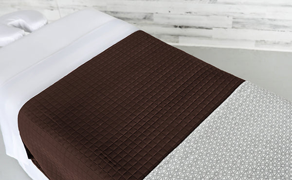 White Linens with a Chocolate Quilted Blanket & an Athena Premium Saddle