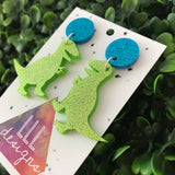 Super Rad Glitter Trex Dino Dangle Earrings. Daring Dino Dangles. Impress all the cool kids with these Dino Dangles ;) Be Bold - Be You!!!