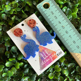 Dinosaour Earrings. Brontosaurus Glitter Blue Statement Dangle Statement Dangle Earrings with Dusty Rose Pink Tops.