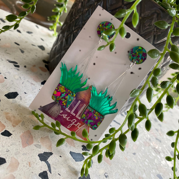 Hanging Planter Dangle Earrings. Featuring Stunning Purple and Green Holographic Planters Hung from Matching Circular Tops.