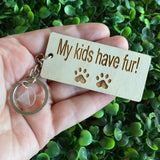 """My kids have fur!"" Quirky Timber Keyring - Laser Cut & Etched on Timber with Silvertone Hardware finished with a LLL Logo Tag."