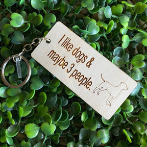 """I like dogs & maybe 3 people"" Quirky Timber Keyring - Laser Cut & Etched on Timber with Silvertone Hardware finished with a LLL Logo Tag."