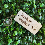 """This is the key to happiness! :)"" Quirky Timber Keyring - Laser Cut & Etched on Timber with Silvertone Hardware finished with a LLL Logo Tag."