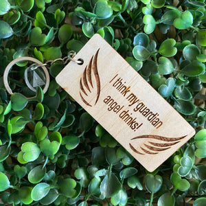 """I think my guardian angel drinks!"" Quirky Timber Keyring - Laser Cut & Etched on Timber with Silvertone Hardware finished with a LLL Logo Tag."