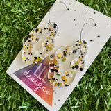 Stunning Clear Wiggle Jiggle Drops featuring Polka Dot Confetti Scattered Throughout. Creating a beautiful visual effect. (Gold/White/Black).