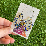 Stunning Clear Wiggle Jiggle Drops featuring Polka Dot Confetti Scattered Throughout. Creating a beautiful visual effect. (Gold/Black/Blue).
