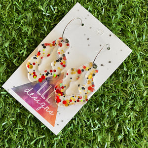 Stunning Clear Wiggle Jiggle Drops featuring Polka Dot Confetti Scattered Throughout. Creating a beautiful visual effect. (Gold/Red/Black).