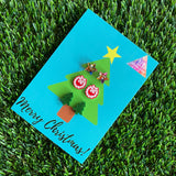 Earring Christmas Card - The Perfect all in one gift! Contains 3 pairs of Stunning Christmas Earrings adorning a brightly coloured Christmas Tree with a Christmas To and From on the Reverse. (Style 3- Christmas Wreath).