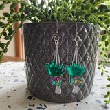 Hanging Planter Dangle Earrings. Featuring Stunning Purple and Green Holographic Planters hanging from Surgical Stainless Steel Hooks.