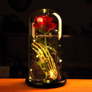 """Beauty and The Beast""  Red Silk Rose in Glass with Skeleton Hand"